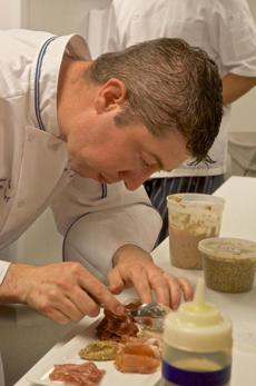 Executive chef Stephen Coe (top) at work in the Inn's kitchen for the restaurant Henri-Marie.